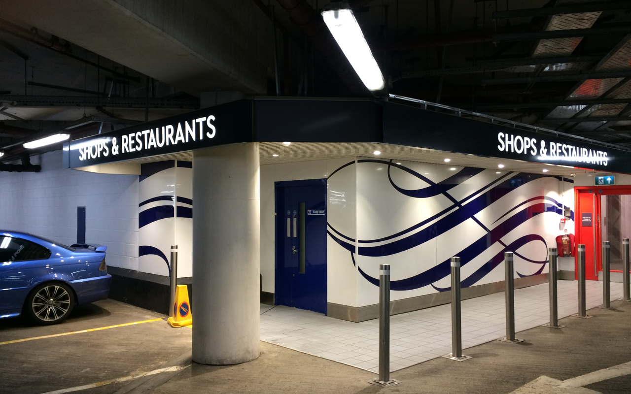 underground car park with illuminated lettering