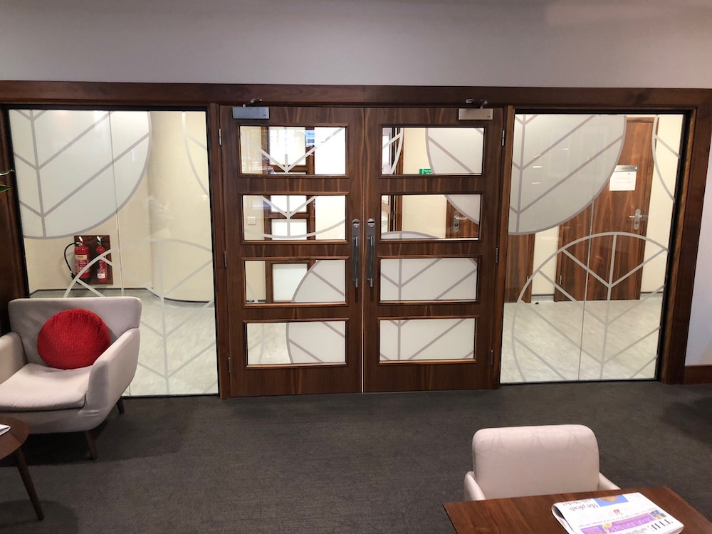 vinyls on internal glass doors with wooden framing
