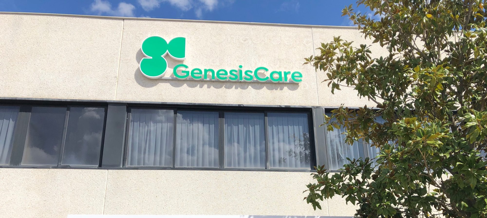 genesis care logo signage on side of building