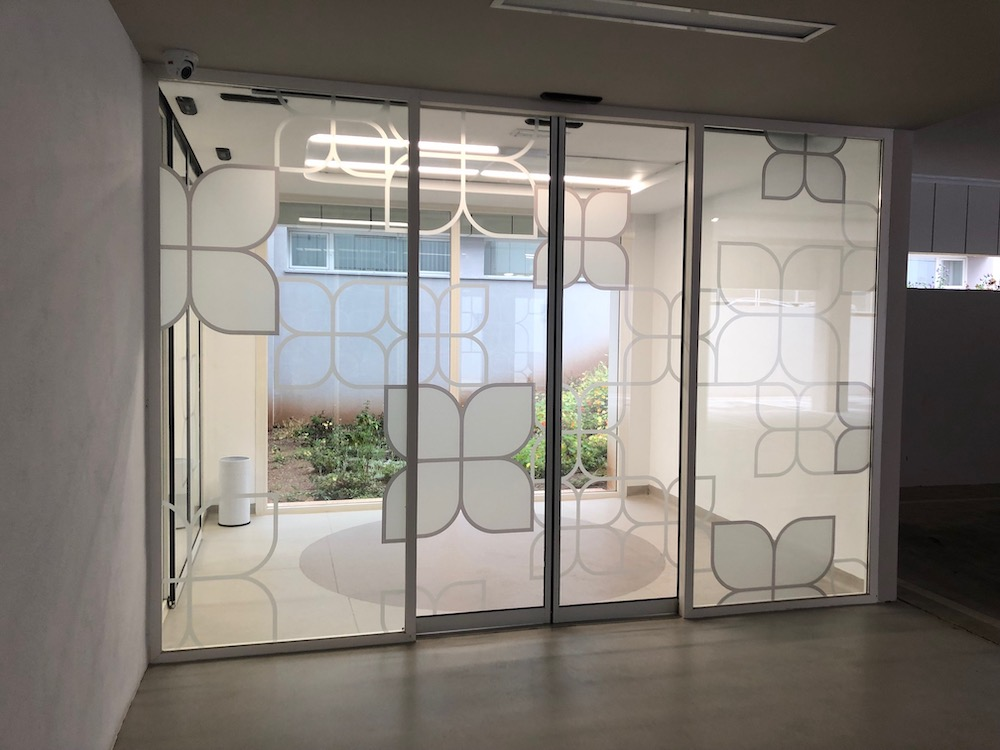 glass entrance doors with vinyl on